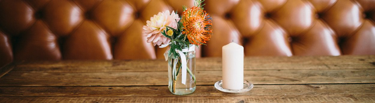 Wooden table flowers in jam jar